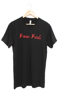 Femme Fatale red graphic design on a soft, 100% cotton black t-shirt. All of our unisex t-shirts are silk screened for the highest quality possible.