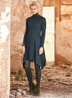 Our contemporary tunic-dress is fine gauge knit of lightweight pima and detailed with a ribbed t-neck and fitted bodice. Side panels create a flared, side-draping hemline that floats easily over tights, leggings or skinny jeans.