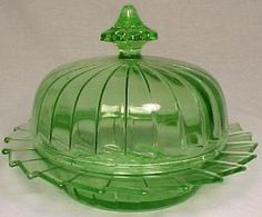 "Sierra ""Pinwheel"" Green Butter Dish   This green butter with lid is in the Sierra or ""pinwheel"" pattern made by the Jeannette Glass Company from 1930 to 1933."