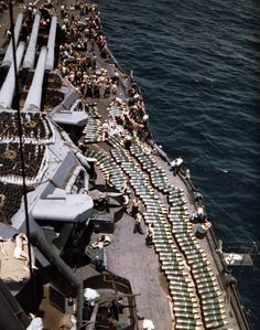 USS New Mexico (BB-40) 14-inch projectiles on deck, while the battleship was replenishing her ammunition supply prior to the invasion of Guam, July 1944. The photograph looks forward on the starboard side, with triple 14/50 gun turrets at left. Note floater nets stowed atop the turrets. Official U.S. Navy Photograph, now in the collections of the National Archives.