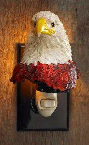 """Eagle Night Light by Wild Wings. $29.99. Cold cast and beautifully hand-painted. Placed up high and down low, this bald eagle keeps a close eye on all your comings and goings!. Night lights are opaque by day; translucent at night; UL listed with bulb included. Sizes vary from 3-7.5"""" H. Placed up high and down low, this bald eagle keeps a close eye on all your comings and goings! Cold cast and beautifully hand-painted. Night lights are opaque by day; translucent at n..."""