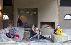 Peter, Larissa and their children Liv, seven, and Ocean, five, enjoy spending time together in the living area. The walls are covered with s...