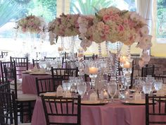The most glamorous floral centerpieces with hydrangeas, roses, orchids and strands of crystals. Posh Peony Floral and Event Design.