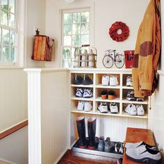 Turn an empty stair landing into a compact mudroom:  Replace open railings with half walls and create a recess for a boot bench. Clad the half walls with beadboard to make them more durable than drywall. Coat them with glossy paint so they are easier to keep clean of scuff marks.   Photo: Tria Giovan
