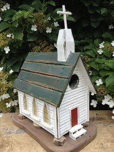 Church Birdhouse.  Doesn't that look real sitting on them rocks...