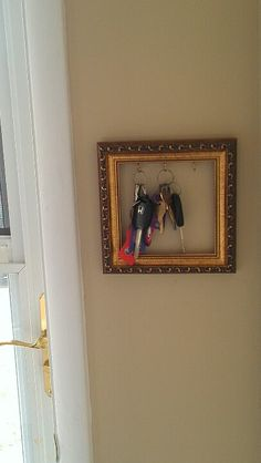 Repurposed picture frame key hanger
