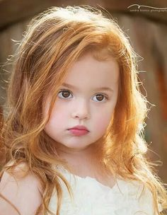 She is beautiful. I have a daughter who is a red head and this so reminds me of her when she was little. Her hair was a deeper color tho, but those lips where the same.