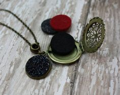 Essential Oil Diffuser Necklace- Aromatherapy Necklace- Antique Bronze Druzy Necklace- Midnight Faux Druzy Diffuser Necklace- Black Druzy Necklace- Starry Night Necklace  Would you love to have your favorite essential oils diffusing right under your nose? My essential oil diffuser necklaces allow you to have just that, and have a stylish statement piece at the same time! An antique bronze filigree locket behind a beautiful midnight faux druzy charm which is firmly fastened to an antique…