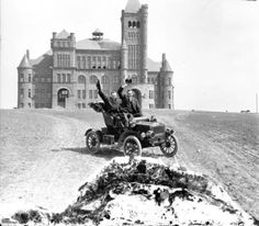 Westminster College, now Pillar of Fire Church atop a hill overlooking Denver, Colorado - Harry Rhoads (photographer) behind steering wheel :: Western History