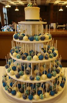 Peacock Colors Wedding Cake Pop Tower... i think i like this. ... very easy for the guests