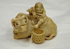 Netsuke of Ox with Bokudo ~  late 19th century Japan ~ Ivory  H. 1 1/2 in. (3.8 cm); W. 1 3/4 in. (4.4 cm); D. 1 1/2 in. (3.8 cm)