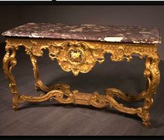 A Fine French Régence Carved and Giltwood Console Table, Circa 1720, H: 82.5 cm (2 ft. 8 ½ in.), W: 150 cm (4 ft. 11 in.), D: 70 cm (2 ft. 3 ½ in.)http://www.pelhamgalleries.com/