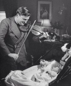 Yehudi Menuhin playing for his baby