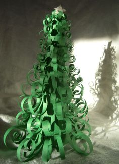 Marvelously Messy: Curly Christmas Tree  This would be cute made with old Christmas cards