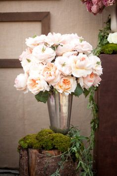 Roses, moss and a tarnished silver vase. Floral Design By / Holly Flora