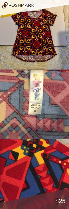 NWOT Lularoe Classic T Beautiful Print never worn  I am not a LuLaRoe consultant, just an avid collector! I've tried many styles, patterns, and fabric types and am looking for loving homes for ones that I do not need in my collection.  Fast shipping M-F!! Same day if purchased before 12:30noon PST and anything after will ship next day! LuLaRoe Tops Tunics
