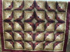 Kinabalu by Jessica's Quilting Studio, via Flickr. The quilting makes these off-set log cabin blocks look like fans. Designed by Jessica Jones; quilted by Jessica's Quilting Studio.