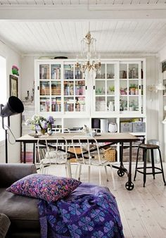 Plain whites with pops of color in the pillows; I love the large book shelf with books and plants