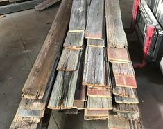 Red and Gray Reclaimed Barn Wood Wall Panel- Easy Peel and Stick Application Sq Ft Reclaimed Barn Wood) by ChicagoFabrications Barn Siding, Wood Siding, Into The Woods, Rustic Wood Walls, Reclaimed Barn Wood, Wooden Walls, Natural Paint Colors, Cover Wood Paneling, Barn Wood Projects