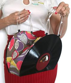 Tuppence Ha'penny: How to Make a Vinyl Record Purse (tutorial not clear at all but you can sort of guess how to from the picture)