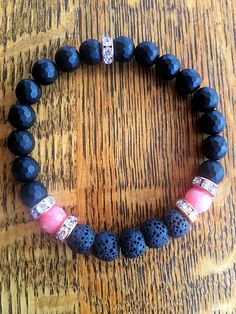 This product is an essential oil diffuser bracelet. It contains pink salmon and faceted black beads, black lava beads, and rose gold spacer beads with crystal accents, all 8mm. The circumference is 7.5 inches. This will fit the average sized wrist. To use: apply 1 drop to each lava
