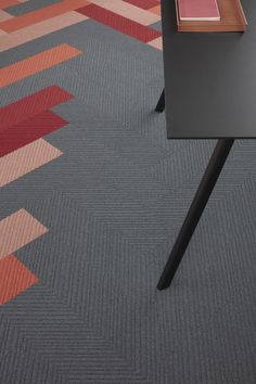 Drawing inspiration from Modernism, Traverse carpet planks uses simple, diagonal lines and tonal shades to create an appearance of movement on the floor, subtly changing from different vantage points.