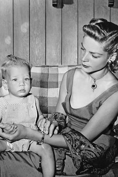 Lauren Bacall's Best Fashion Looks Through the Years - Style Photos of Lauren Bacall - Elle.........Lauren Bacall at home with her son, Stephen Humphrey, circa 1955