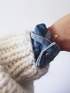 {Chunky white knit, denim shirt, fine jewellery.}