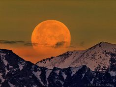 Full moon setting over the Sierra Nevada mountains, California, New Years Day, 2010.
