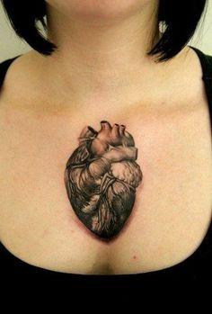 I love me a well done anatomical heart tattoo.