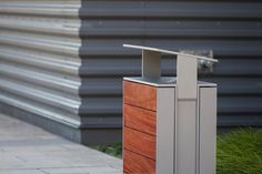 Apex Receptacle in 36 gallon, split-stream configuration with Aluminum Texture powdercoated lid, body and optional rain cover; insets in FSC 100% Jatoba hardwood