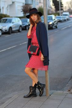 DÜSSELDORF, GERMANY - FEBRUARY 19: German fashion blogger and model Alexandra Lapp is wearing a flounce dress in red from Steffen Schraut, a midnight blue blazer by Steffen Schraut, Maison Michel Virginie rabbit-felt fedora hat in black with a grosgrain ribbon in dark blue with red, that is adorned with the label's logo in the form of a glossy black charm, a boy bag in black and red calfskin and vintage biker boots by Gucci on February 19, 2017 Düsseldorf, Germany. *** Local Caption…