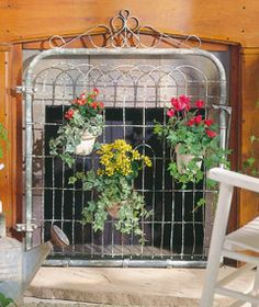 Turn a garden-gate into a cool fireplace screen- with or without plants ( fireplaces also look great with Groups of CANDLES burning in them )