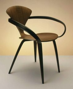 Cherner chair, designed by Norman Cherner, 1957. Made of walnut veneer plywood. Made by Plycraft, Inc. 1957-present. This design was inspired by the Pretzel chair by George Nelson & Associates.