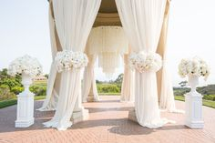 20 Pure White Wedding Decor Ideas for Romantic Wedding. Peonies instead of roses. Love the pearl chandelier.