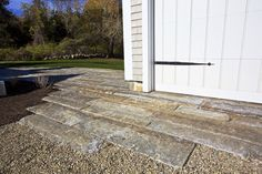 Reclaimed granite curbing laid out in an irregular pattern makes adds a strong visual interest.