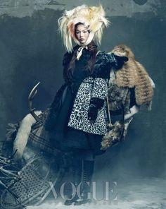 Photographer Hong Jang Hyun captures models Han Hye Jin, Song Kyung Ah, and Jang Yoon Ju  for the January 2012 issue of Vogue Korea.