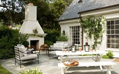 House Tour: Santa Monica Home - Design Chic Wonderful patio  and love the outdoor fireplace - beautiful landscaping!