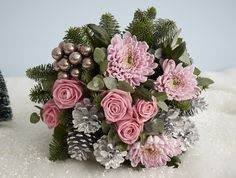 Jane Packer  - Ice Skates, £70.00 (http://www.janepackerdelivered.com/ice-skates/) A feminine soft pink toned bouquet for a girly Christmas gift. Candy pink roses, large blooms and shimmering silver pine cones and combined with fragrant pine and the addition of pewter baubles.  price pictured is 'Signature'.