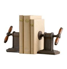 7 Unique Bookends <br> Whether being used to hold up three or placed among 300 books, these weights bring dimension and personality to shelves. Here, seven options that held up against the competition. Rustic Industrial Decor, Industrial Office, Modern Industrial, Rustic Decor, Industrial Bookends, Modern Spaces, Clever Diy, Home Organization, Book Worms