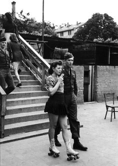 A woman on rollerskates and her beau, 1940s.