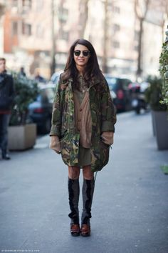 "camouflage jacket - In this photograph there is another woman who has incorporated the ""camo"" print of the army into her every day outfit."
