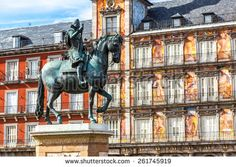 Statue of Philip III at Mayor plaza in Madrid in a beautiful summer day, Spain