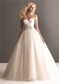 A soft and romantic tulle ball gown. This design features an asymmetrically ruched strapless bodice with a sweetheart neckline and natural waistline defined with beading and floral detail.  allure 2607