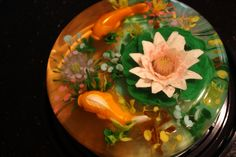 Realistic Fish Pond 100% gluten free - this cake has molded fish and all flowers and underwater sea flowers and weeds are done by injecting...