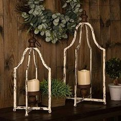 Rustic lanterns are popular this year in home decor for their warmth and charm. Decorate them to make bold statements or simply incorporate them to compliment your decor Hanging Candle Lanterns, Rustic Lanterns, Lantern Candle Holders, Candle Sconces, Lanterns Decor, Glass Candle, Pillar Candles, Flameless Candles, Lantern Set