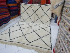 ★ ITEM DESCRIPTION ★    Moroccan rugs are the weaves, carpets, and textiles that have been traditionally hand-woven in Morocco. Rugs have been woven by the indigenous people of Morocco since the Paleolithic Era. Traditionally, Moroccan rugs have been woven by tribal peoples for their utility rather than for decorative purposes. Twentieth-century Moroccan rugs are widely collected in the West, and are almost always woven by tribes people who do not seek nor possess formal artistic training…