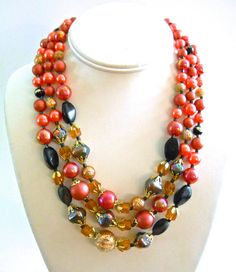 Offering a multi strand #iridescent necklace with crystal, faux pearls in a peach-gold color....vintage  This delightful, triple strand necklace has numerous variety of bead...