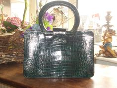 green alligator skin handbag