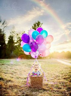 Sweet birthday photo op. First or second birthday. Make a basket look like a hot air balloon with a bundle of colorful balloons tied to the handles.